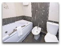 отель Ani Central Inn: ванная люкс