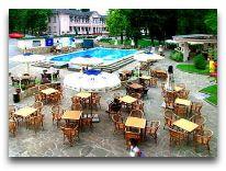 отель Аркадия Плаза: Летнее кафе у бассейна