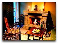 отель Chatcal Mountains: Гостиная в коттедже
