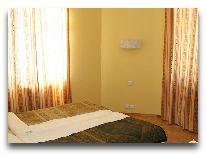 отель Chatcal Mountains: Спальня в коттедже