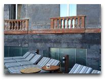 отель Historic Yerevan Hotel Tufenkian: Веранда для загара
