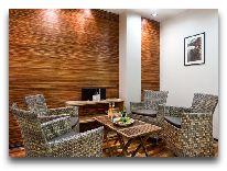 отель L Ermitage: Комната отдыха в сауне
