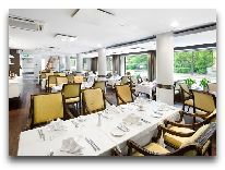 отель L Ermitage: Ресторан L'Ermitage