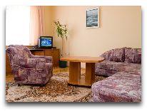отель Liukrena: Гостиная в номере люкс