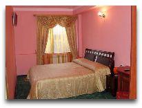 отель World of Gold: Спальня номера Люкс