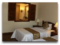 отель Novela Mui Ne Resort & Spa: Кровати и окно в ванну