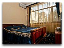отель Одесский Дворик: VIP Апартаменты - спальня