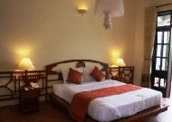 отель Windbell Homestay Hoian Hotel: Вилла Jackfruite - спальня